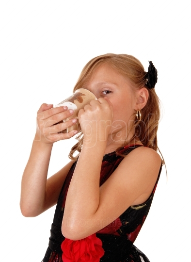 Girl drinking from a mug