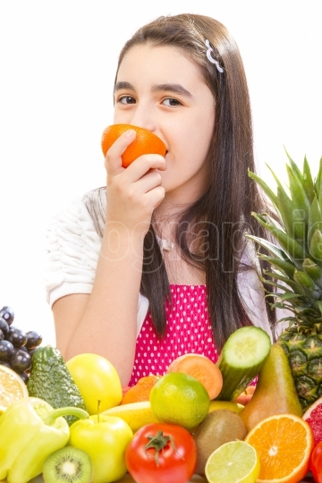 Girl eating a pice of orange