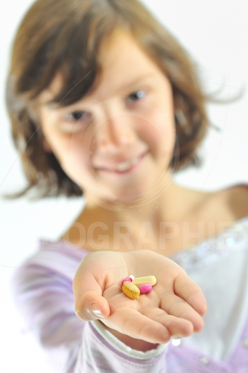 Girl holding  pills