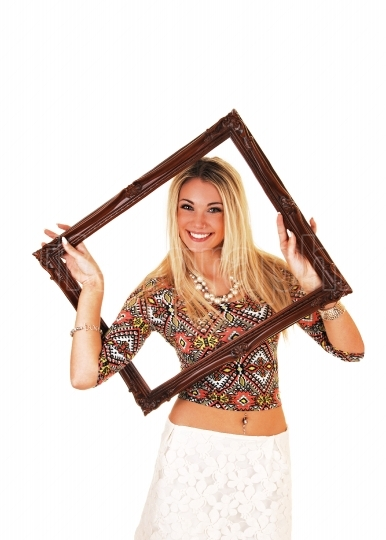 Girl looking trough picture frame