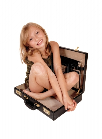 Girl sitting in briefcase