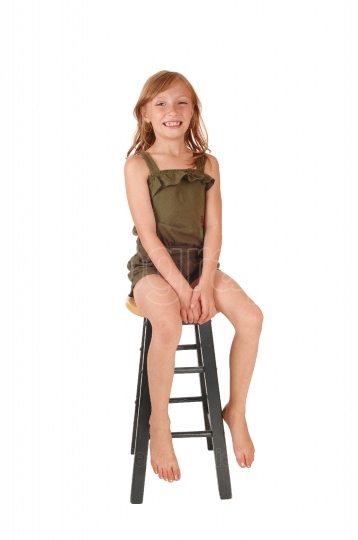 Girl sitting on high chair
