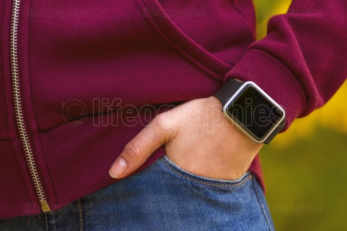 Girl wearing smart watch on her hand