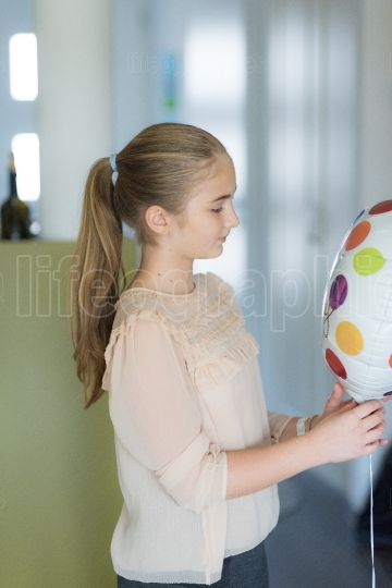 Girl with a ballon have fun by her birthday