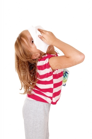 Girl with tissue on her nose