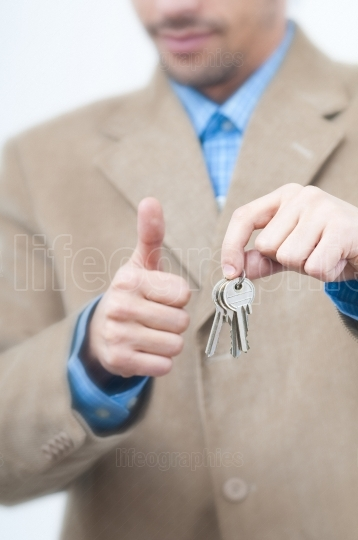 Giving house keys and ok sign