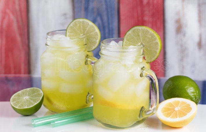 Glass jars filled with cold lemonade on USA national colors for