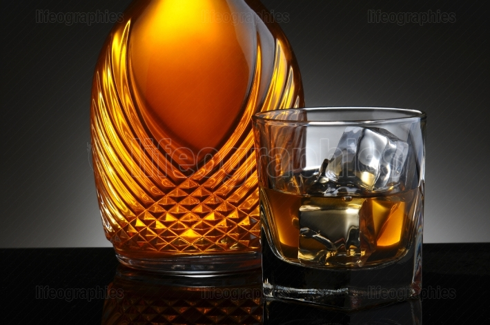 Glass of Scotch and Elegant Decanter