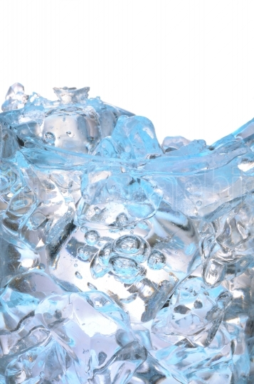 Glass with frozen ice cubes