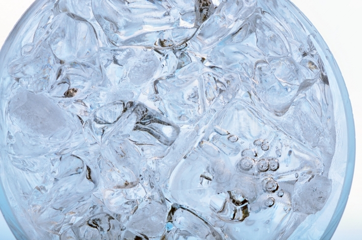 Glass with frozen ice cubes isolated
