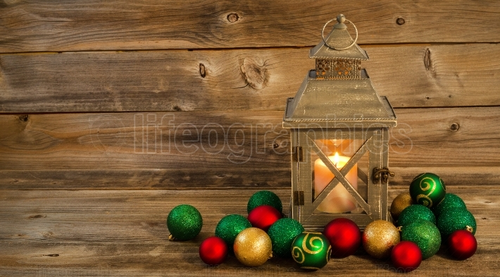Glowing Lantern with Christmas Ornaments on Rustic Wood