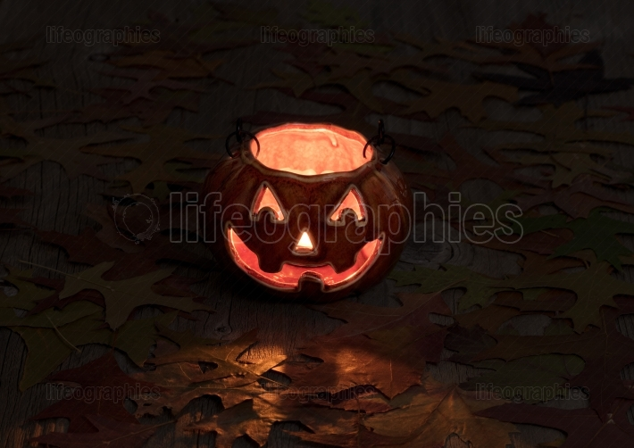 Glowing pumpkin decoration in dark background