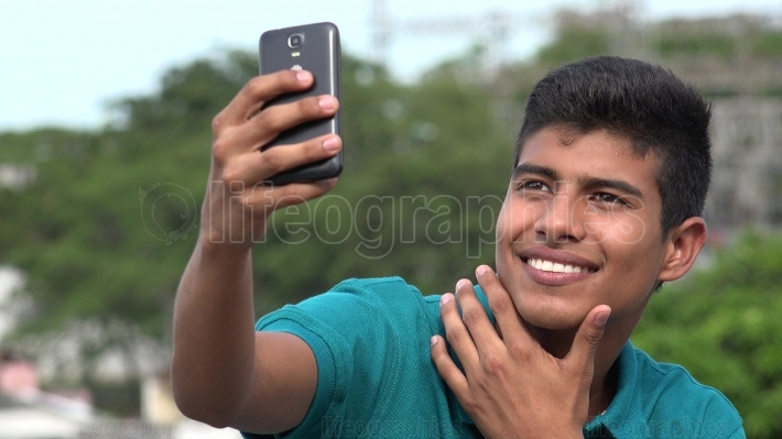 Good Looking Teen Boy Taking Selfy And Smiling