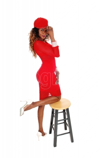 Gorgeous woman in red dress and cap.