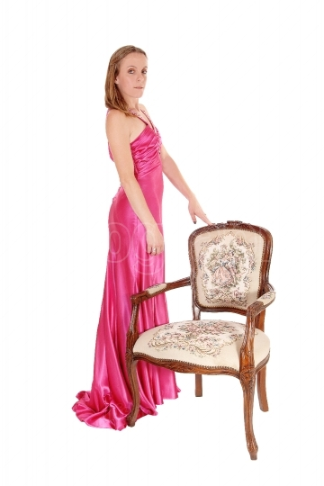 Gorgeous woman standing is a long pink dress