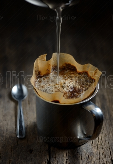 Ground coffee in metal cup