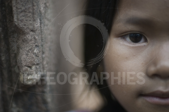 Half portrait of a poor girl from cambodia