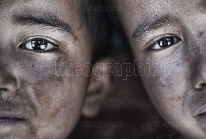 Half portraits of two Tibetan boys