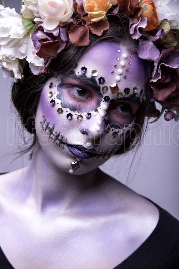 Halloween Fashion Model with Rhinestones and Wreath of Flowers