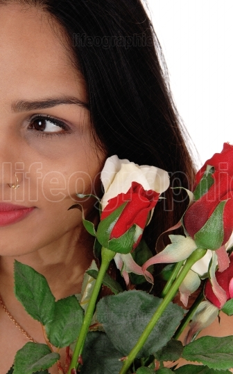 Halve of a face of a woman with roses