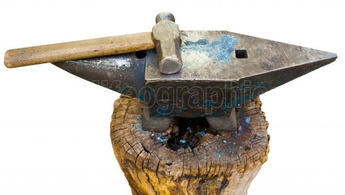 Hammer and anvil used by a blacksmith. isolated on white, with clipping path.