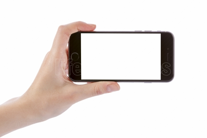 Hand holding black smart phone isolated on white