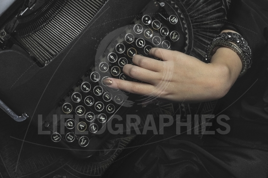 Hand of a woman writing at a typewriter