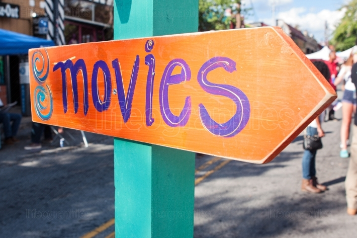Handmade Festival Sign Says Movies And Points In Right Direction