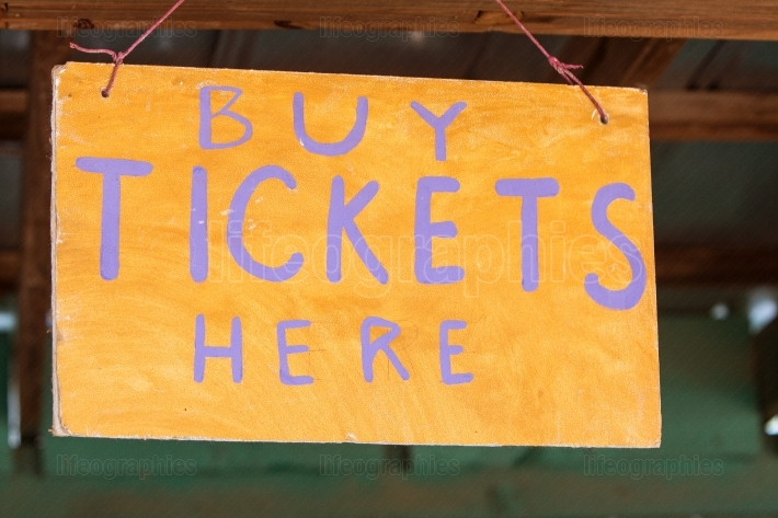 Handmade Sign Instructs Carnival Patrons Where To Buy Tickets