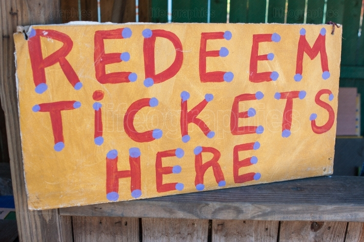 Handmade Sign Instructs Carnival Patrons Where To Redeem Tickets