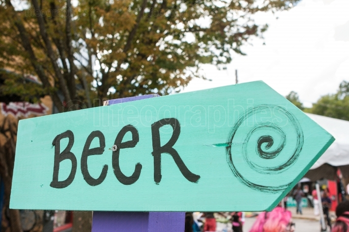 "Handmade Sign Says ""Beer"" At Festival"