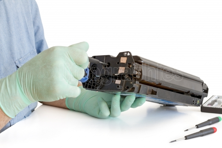 Hands repairing toner cartridge