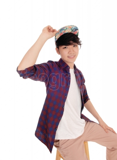 Handsome Asian man with cap.