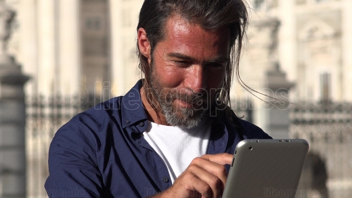 Handsome Male Using Tablet