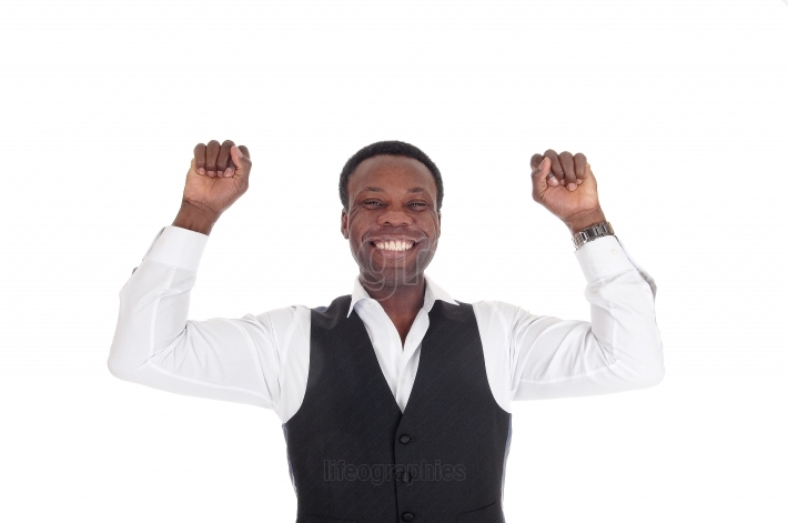 Happy African man with hands raised