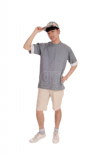 Happy Asian man standing in shorts