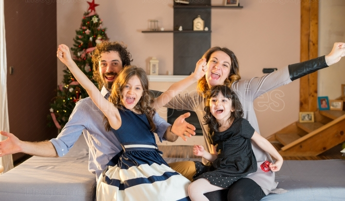 Happy family having fun at home at christmas time