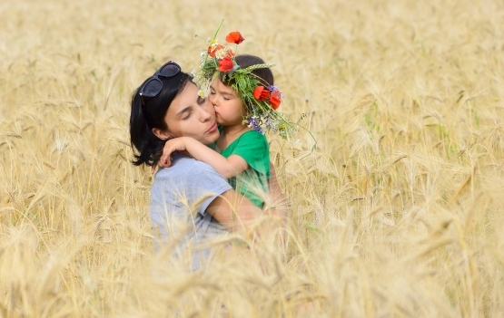 Happy family on a summer meadow. little girl child baby daughter
