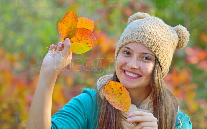 Happy girl with dry leaves
