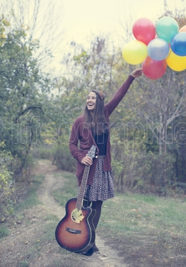 Happy girl with her balloons