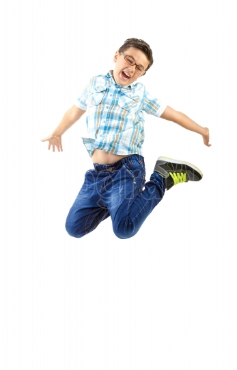 Happy little boy jumping on white