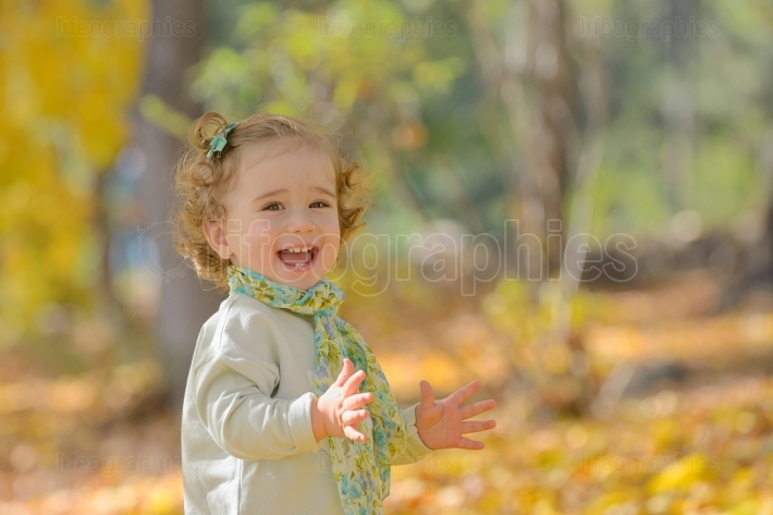 Happy little girl in park