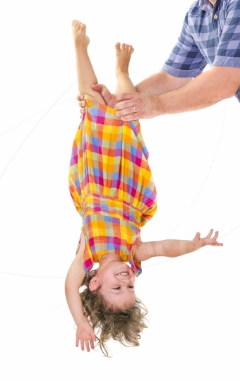 Happy little girl upside down