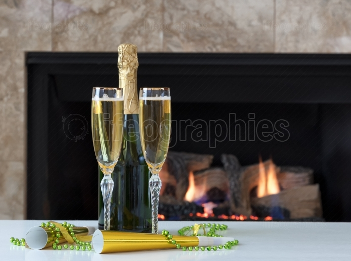 Happy New Year Celebration with Golden Champagne for two and glo