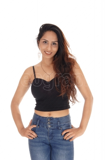 Happy smiling woman in a corset and jeans