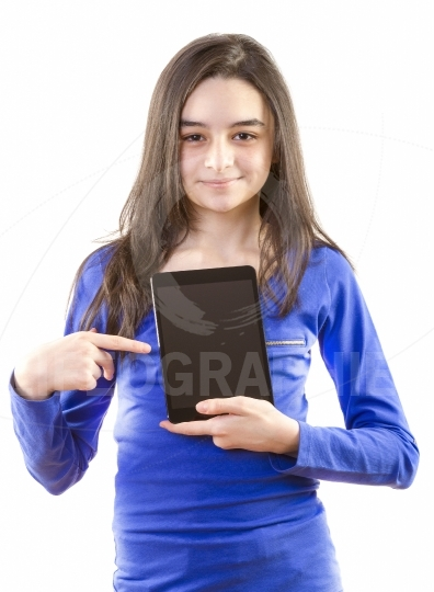 Happy teen girl with digital tablet
