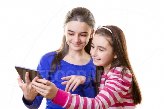 Happy teen girls with digital tablet