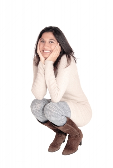 Happy woman crouching on floor