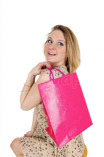 Happy woman with shopping bag.