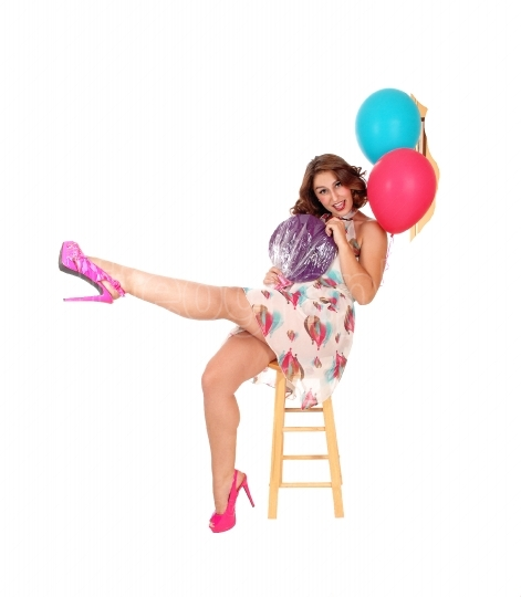 Happy woman with two balloons.